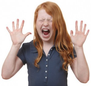 27861747 - portrait of a screaming young girl on white background
